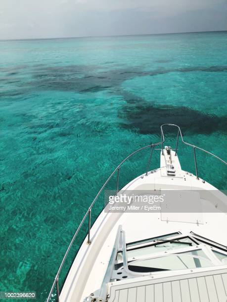 high angle view of ship sailing in sea against sky - florida keys stock pictures, royalty-free photos & images