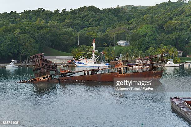 high angle view of shipwreck amidst river - solomon turkel stock pictures, royalty-free photos & images