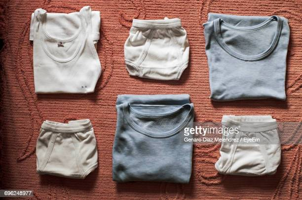 High Angle View Of Shirts And Underwear