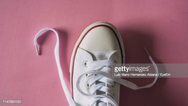 high angle view of shoe on pink background - shoelace stock pictures, royalty-free photos & images