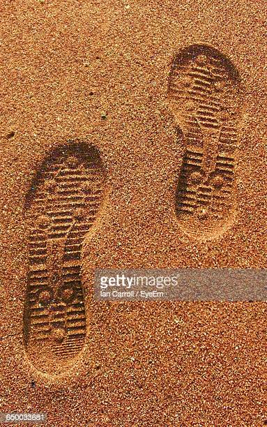 high angle view of shoe print on sand at beach - shoe print stock pictures, royalty-free photos & images