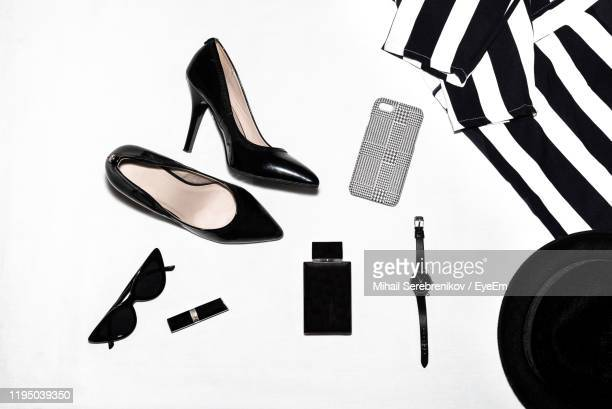 high angle view of shoes and personal accessories on white background - womenswear stock pictures, royalty-free photos & images