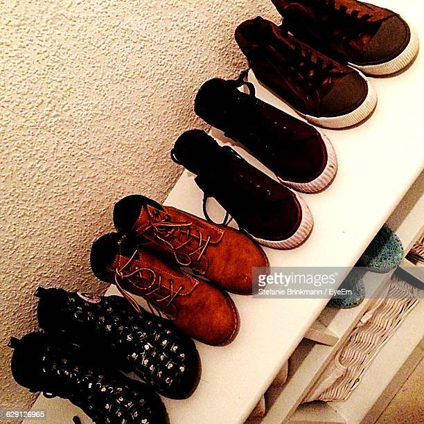 High Angle View Of Shoes In Shelf At Store