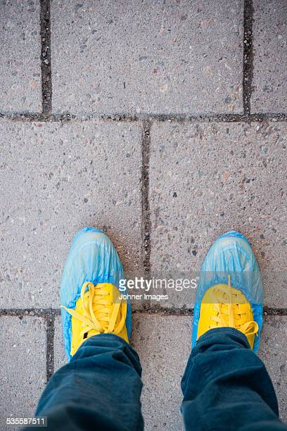 high angle view of shoes in shoe protectors - shoe covers stock pictures, royalty-free photos & images