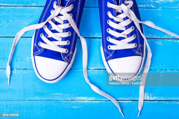 high angle view of shoes on floorboard - shoelace stock pictures, royalty-free photos & images