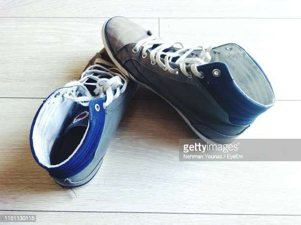 high angle view of shoes on flooring - pair stock pictures, royalty-free photos & images