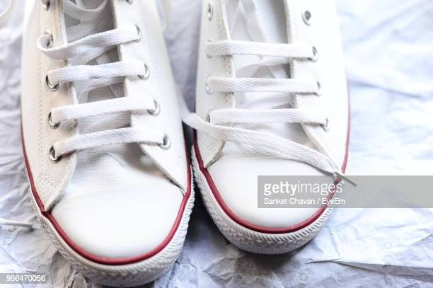 High Angle View Of Shoes On Paper