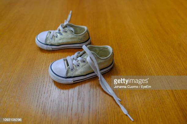 high angle view of shoes on table - cuomo stock pictures, royalty-free photos & images