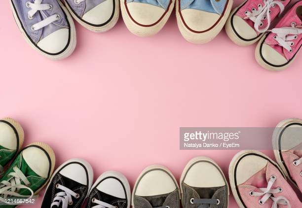 high angle view of shoes on table - paire photos et images de collection