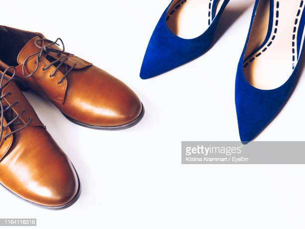high angle view of shoes on white background - pair stock pictures, royalty-free photos & images