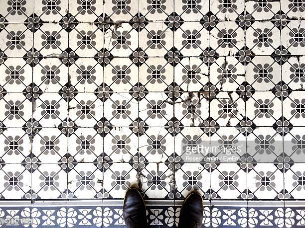 High Angle View Of Shoes Tiled Floor