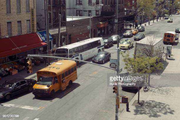 high angle view of short school bus on the streets of brooklyn in new york city, usa - queens new york city stock pictures, royalty-free photos & images