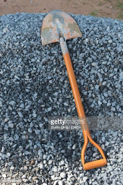 High Angle View Of Shovel On Gravels