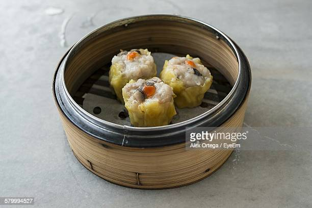 High Angle View Of Shumai In Container On Table