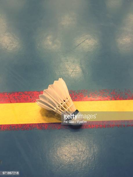 high angle view of shuttlecock on sport court - shuttlecock stock pictures, royalty-free photos & images