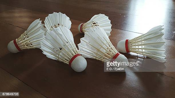 high angle view of shuttlecocks on hardwood floor at home - shuttlecock stock pictures, royalty-free photos & images