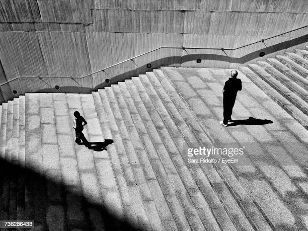 High Angle View Of Silhouette Of People On Steps