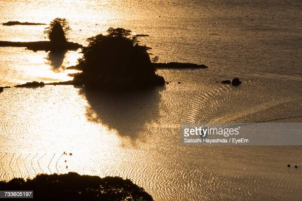 High Angle View Of Silhouette Shore At Beach During Sunset