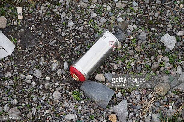 High Angle View Of Silver Spray Can On Gravel