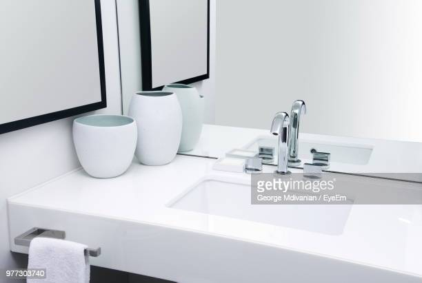 high angle view of sink against mirror in bathroom - lavandino foto e immagini stock