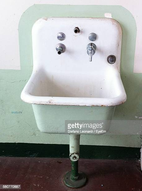 high angle view of sink against wall in bathroom - wash bowl stock pictures, royalty-free photos & images