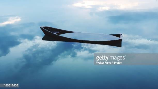 high angle view of sinking boat - sinking stock pictures, royalty-free photos & images