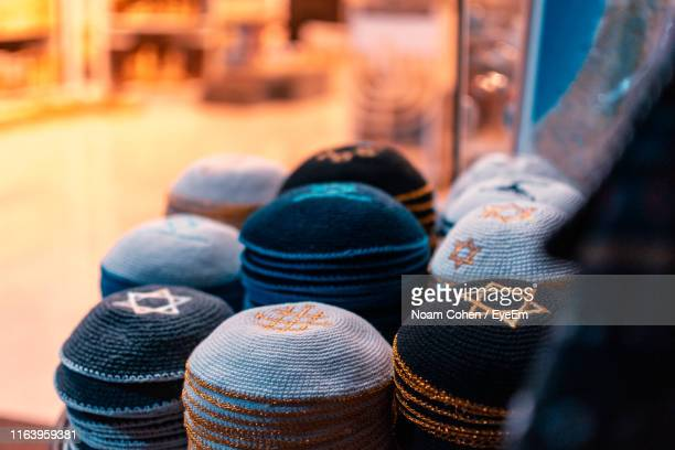 high angle view of skull caps for sale in store - noam cohen stock pictures, royalty-free photos & images