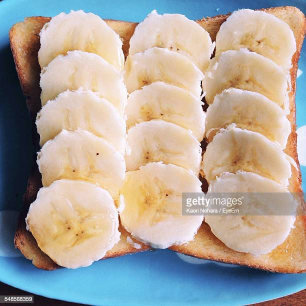 High Angle View Of Sliced Bananas Arranged On Bread On Plate