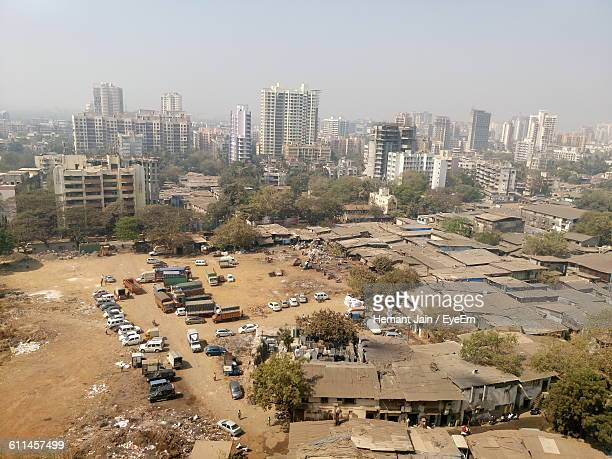 high angle view of slums in city against sky - slum stock pictures, royalty-free photos & images