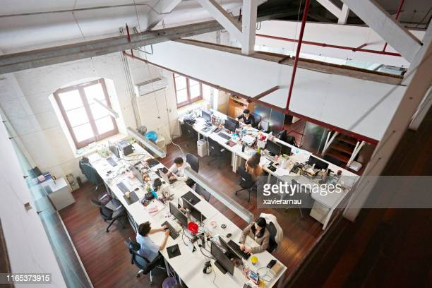 high angle view of small design business in shanghai - small group of people stock pictures, royalty-free photos & images