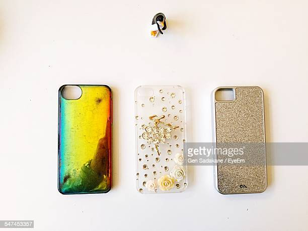 High Angle View Of Smart Phone Covers On White Table
