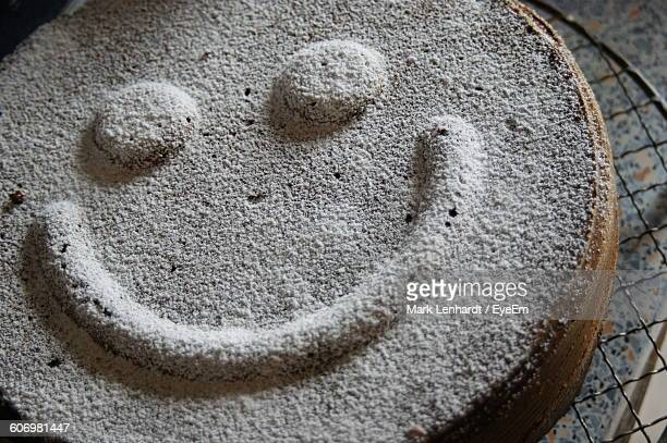 High Angle View Of Smiley Face On Cake