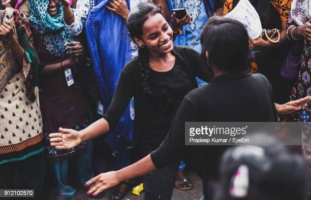 high angle view of smiling women performing on street - india summer stock-fotos und bilder