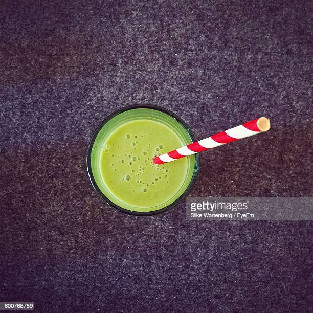 High Angle View Of Smoothie In Glass On Table