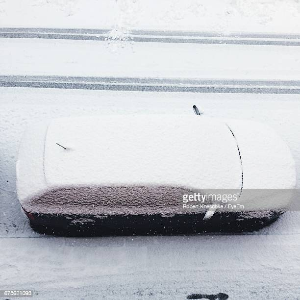 High Angle View Of Snow Covered Car On Street