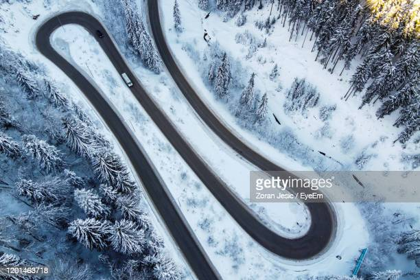 high angle view of snow covered car - snowcapped mountain stock pictures, royalty-free photos & images
