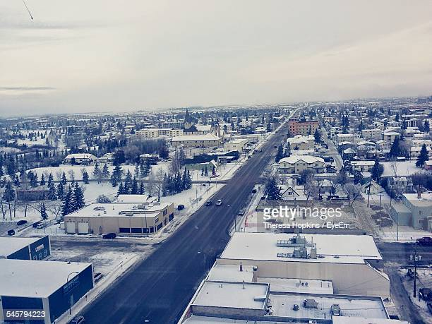 High Angle View Of Snow Covered Cityscape Against Sky