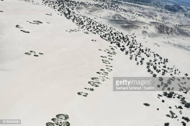high angle view of snow covered land - gerhard schimpf stock photos and pictures