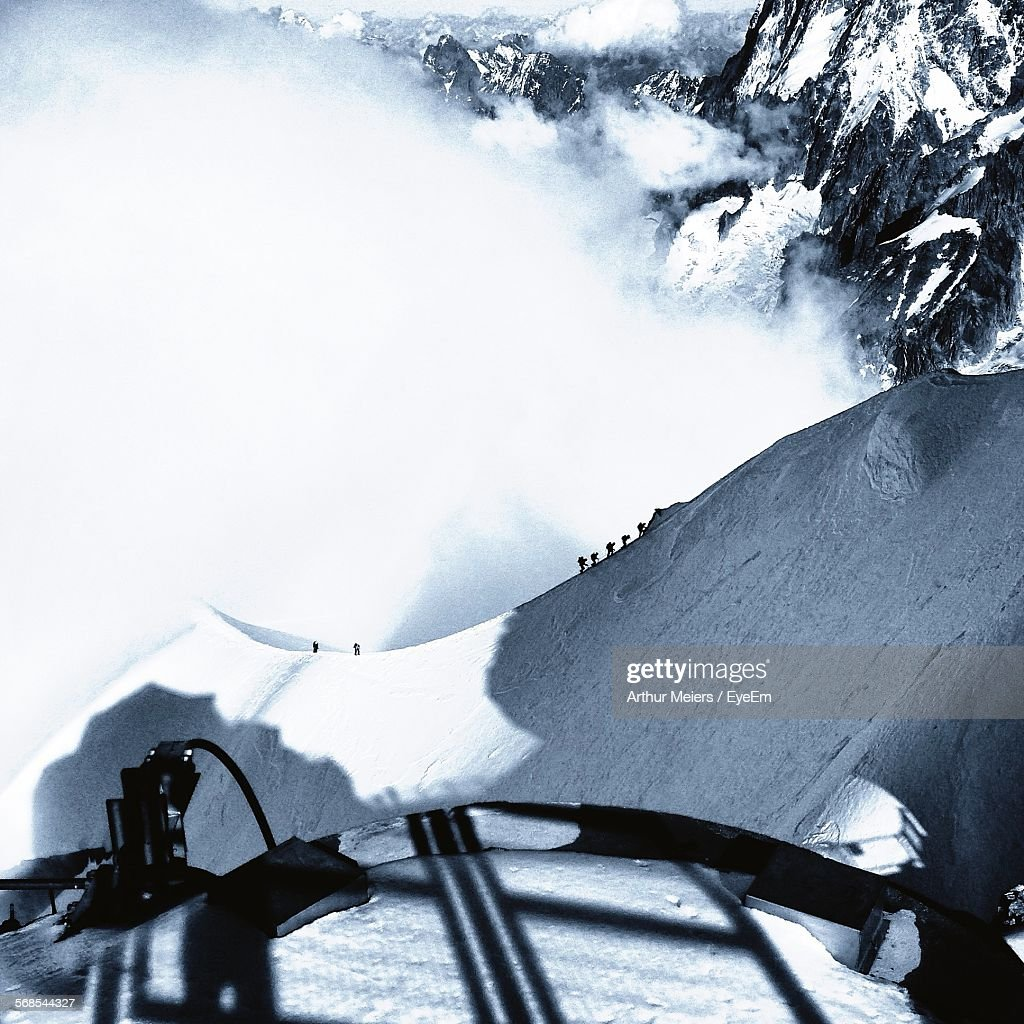 High Angle View Of Snow Covered Mountains During Foggy Weather : Stock Photo