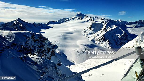 High Angle View Of Snow Covered Mountains