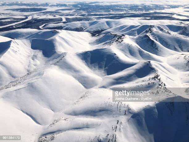 high angle view of snowcapped landscape - duchene stock photos and pictures