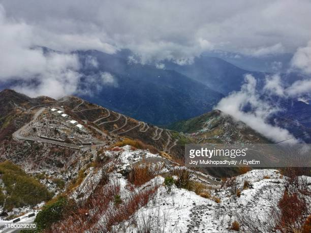 high angle view of snowcapped mountains against sky - sikkim stock pictures, royalty-free photos & images
