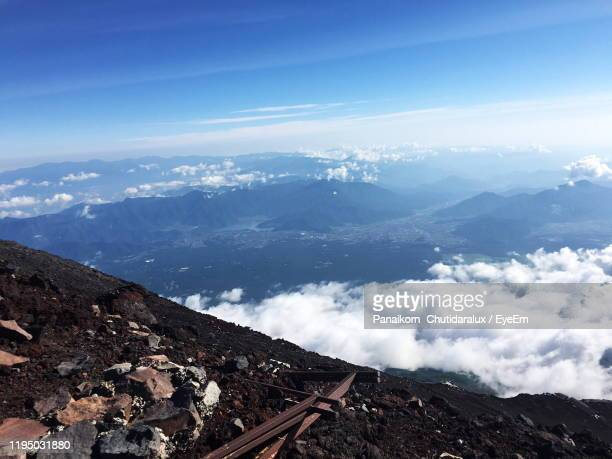 high angle view of snowcapped mountains against sky - panaikorn chutidaralux stock photos and pictures