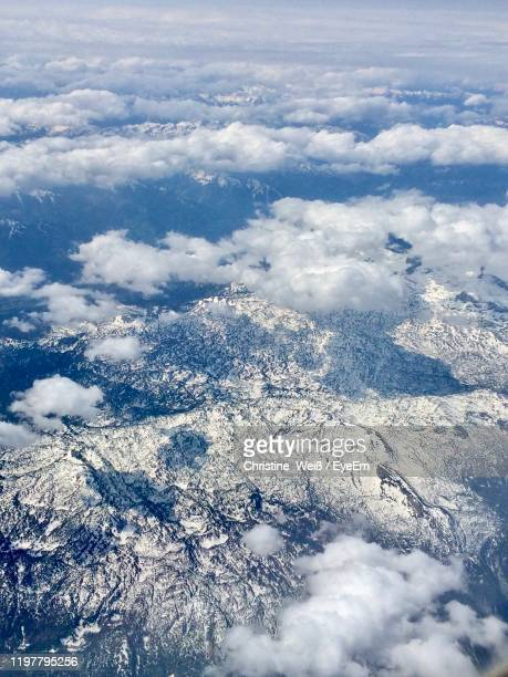 high angle view of snowcapped mountains against sky - weiß stock pictures, royalty-free photos & images