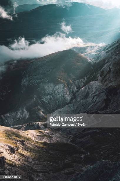 high angle view of snowcapped mountains and sea - fabrizio zampetti foto e immagini stock