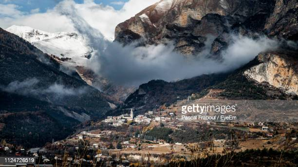 high angle view of snowcapped mountains - embrun stock pictures, royalty-free photos & images