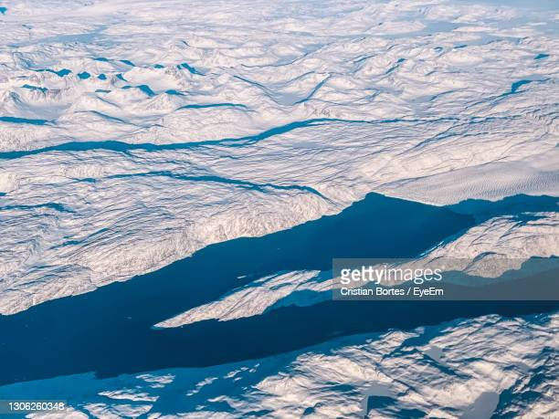 high angle view of snowcapped mountains - bortes stock-fotos und bilder