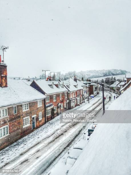 High Angle View Of Snowy Houses Against Sky