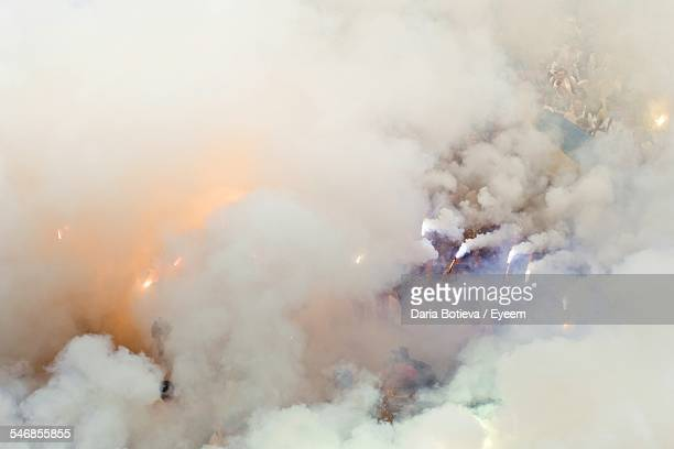 high angle view of soccer fans holding ultras - flare stack stock photos and pictures