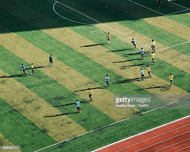 High Angle View Of Soccer Player Playing On Field